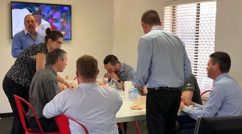 The teams having a quick bite